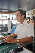 Naval officer in the control room of the 'Kalimantan Palm'. Cargo ship from Singapore which transports palm oil. Port of Southampton.